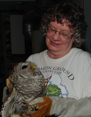 Marilyn holds a Barred Owl